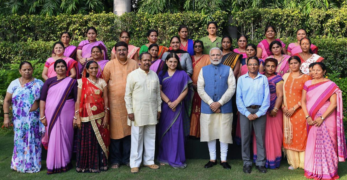 Prime Minister Narendra Modi poses for photos with Anganwadi workers from across the country, in New Delhi on Wednesday, Sept 19, 2018. Union Minister for Women and Child Development Maneka Sanjay Gandhi is also seen. PTI