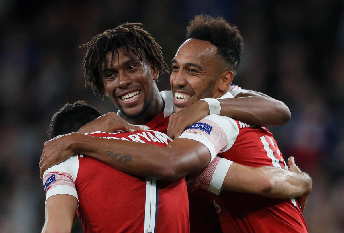 Arsenal's Pierre-Emerick Aubameyang (right) celebrates scoring their third goal with Henrikh Mkhitaryan and Alex Iwobi (centre). REUTERS