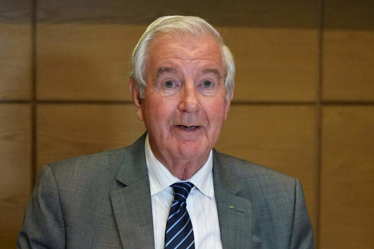 Craig Reedie, president of the World Anti-Doping Agency (WADA), speaks to the press after a meeting of the executive committee on September 20, 2018, in Victoria, capital of the Indian Ocean island of Seychelles. WADA lifted a ban on Russia's anti-doping