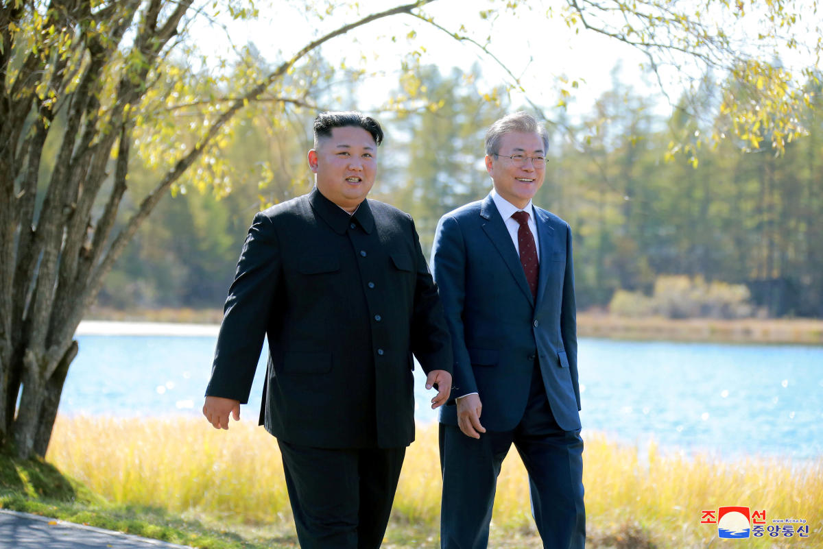 South Korean President Moon Jae-in and North Korean leader Kim Jong Un walk during a luncheon, in this photo released by North Korea's Korean Central News Agency (KCNA) on September 21, 2018. REUTERS