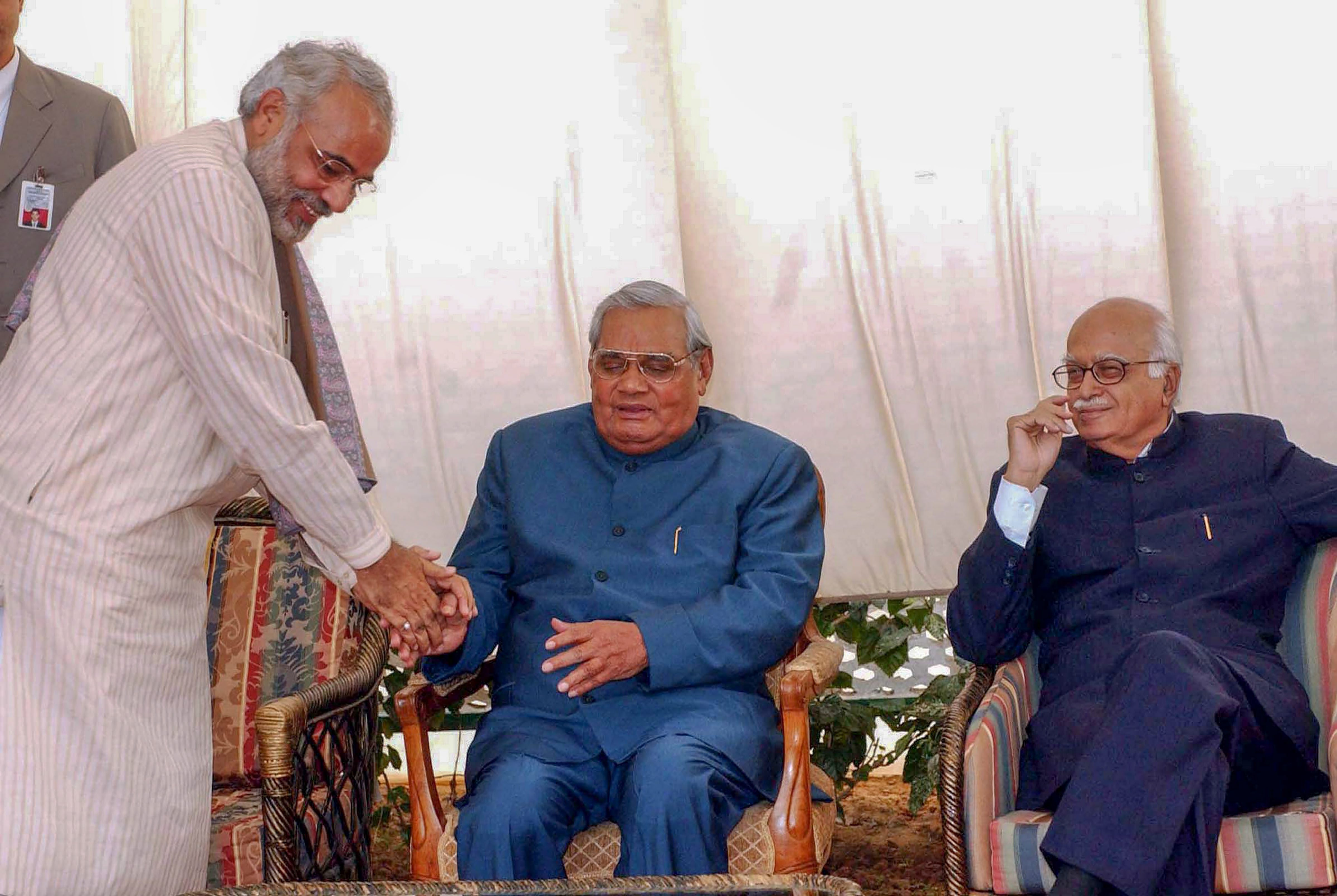 In this December 09, 2003, file photo former prime minister Atal Bihari Vajpayee is seen with the then Gujarat CM Narendra Modi and BJP senior leader LK Advani at a lunch in New Delhi. PTI