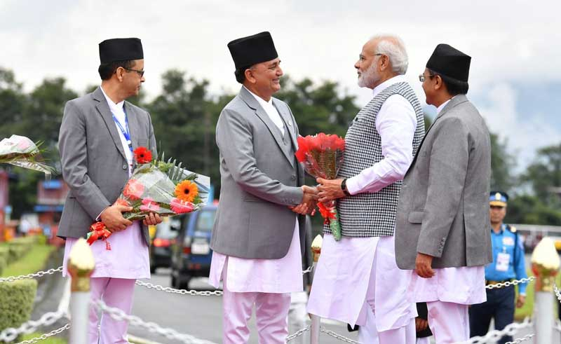 Ishwar Pokhrel, Deputy Prime Minister and Defence Minister of Nepal receives Prime Minister Narendra Modi on arrival at Kathmandu airport. (Photo credit: @MEAIndia/Twitter)