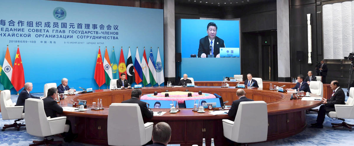 Narendra Modi and Chinese President Xi Jinping are seen along with other heads of state at a meeting at the Shanghai Cooperation Organization (SCO) summit in Qingdao. Reuters