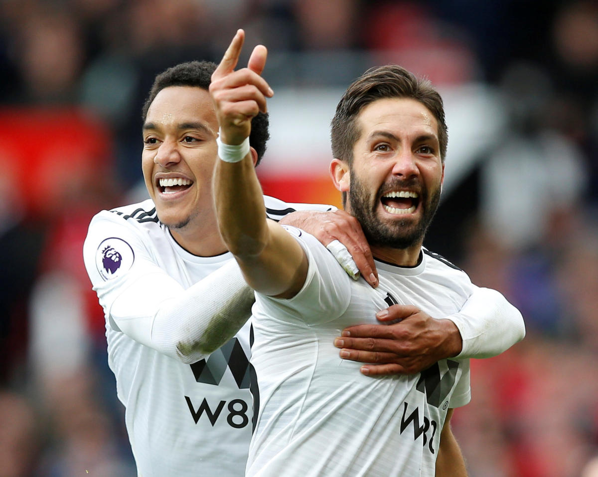 FINE FINISH: Wolverhampton Wanderers' Joao Moutinho (front) celebrates with Helder Costa after scoring against Manchester United on Saturday. REUTERS