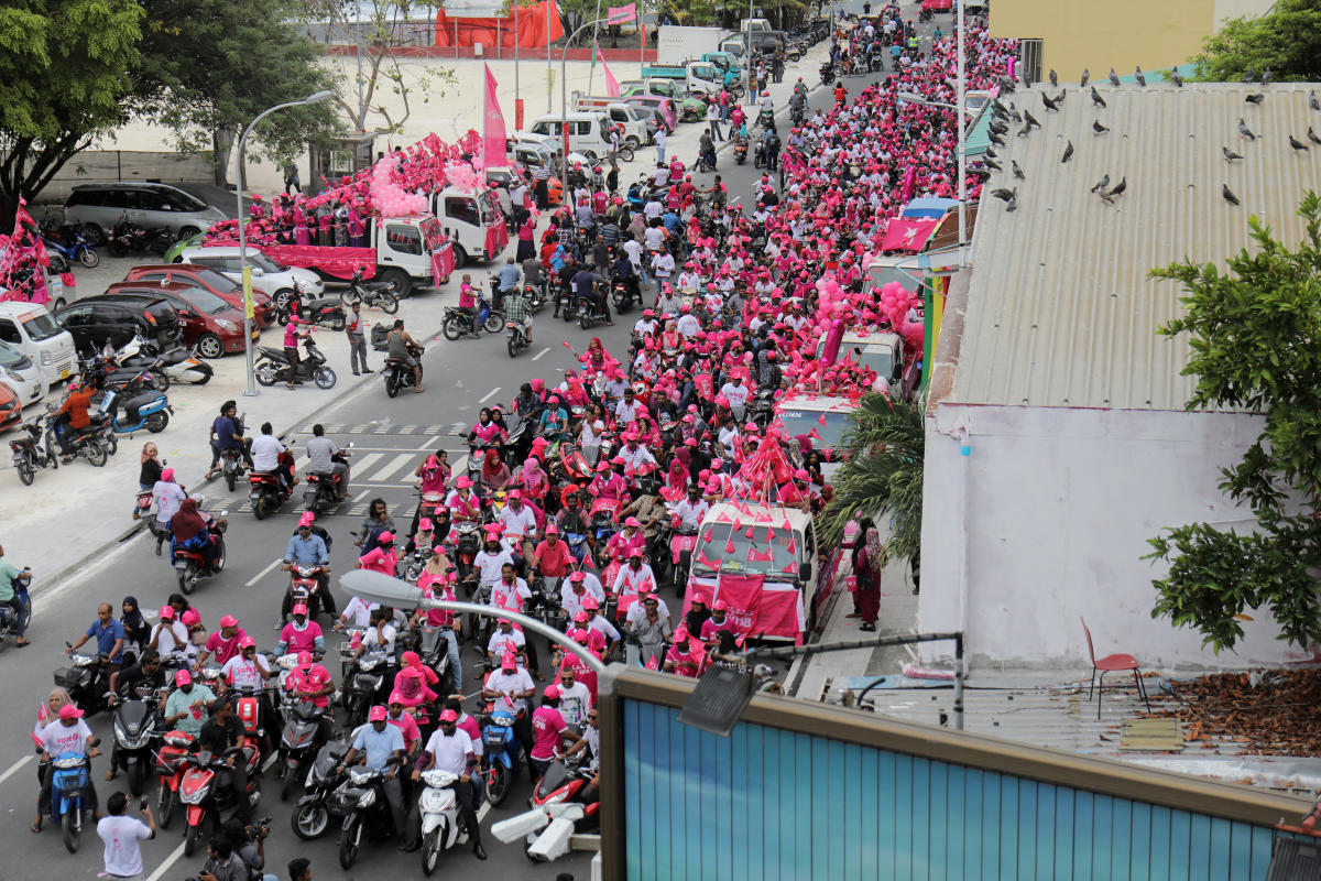 Supporters of the Maldivian President Abdulla Yameen ride on their bikes during the final campaign march rally ahead of their presidential election in Male. Reuters.