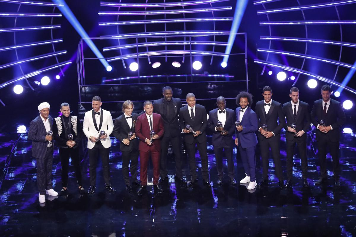 London : Host Idris Elba, center, poses with the 11 players of the top team with players David De Gea, Dani Alves, Marcelo, Sergio Ramos, Raphael Varane, Eden Hazard, N'Golo Kante, Luka Modric, Cristiano Ronaldo, Kylian Mbappe and Lionel Messi during the ceremony of the Best FIFA Football Awards in the Royal Festival Hall in London, Britain, Monday, Sept. 24, 2018. AP/PTI
