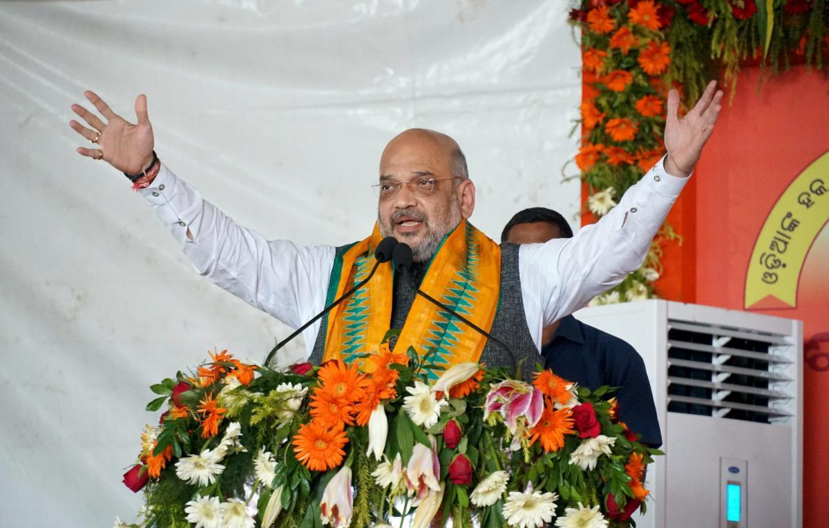 BJP chief Amit Shah addresses a gathering during a three-day national executive meet of the party's women's wing in Puri on Monday. PTI