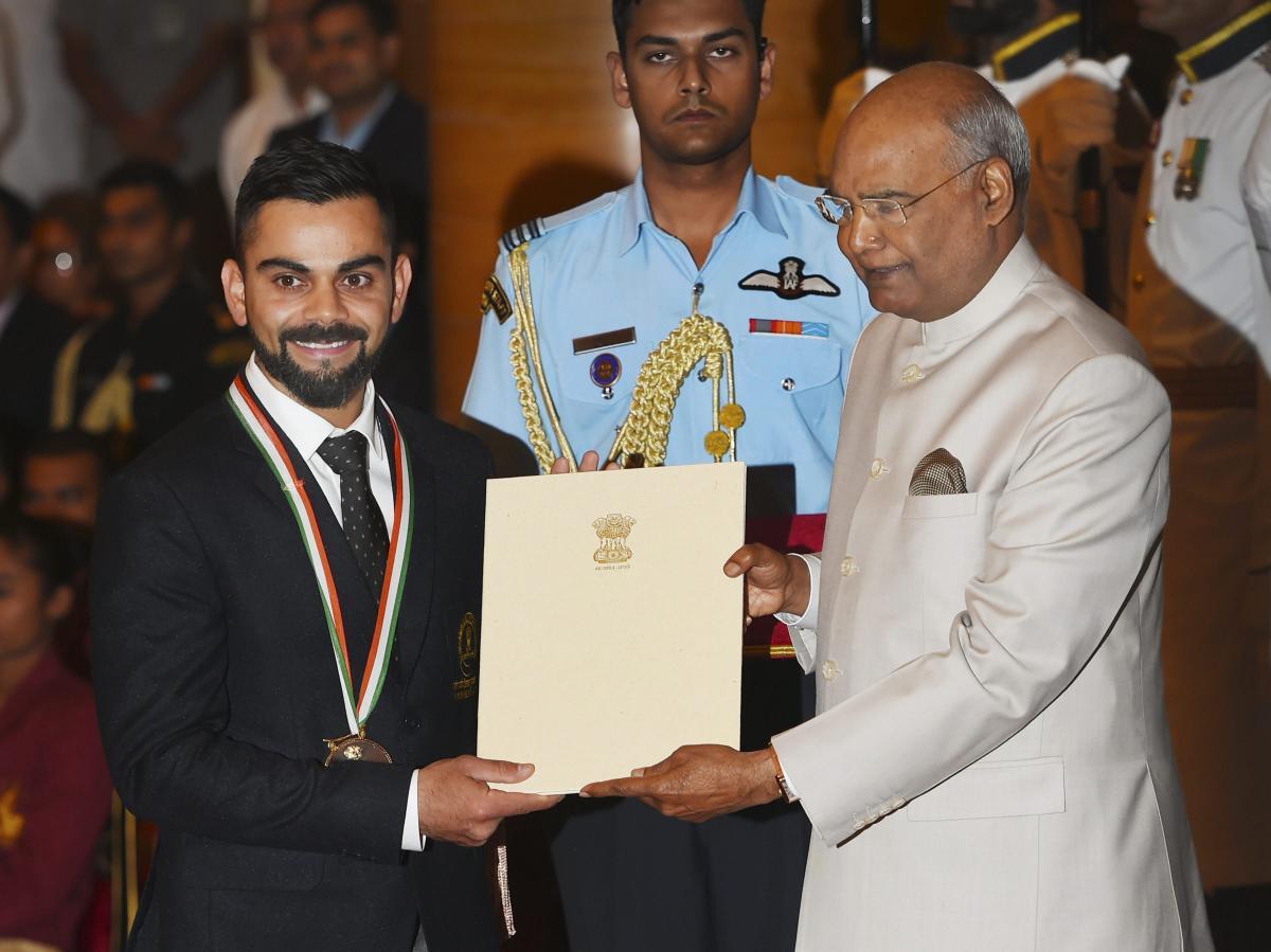 President Ram Nath Kovind confers Rajiv Gandhi Khel Ratna award on cricketer Virat Kohli at the National Sports and Adventure Award 2018 function at Rashtrapati Bhawan in New Delhi, Tuesday, Sep 25, 2018. (PTI Photo)