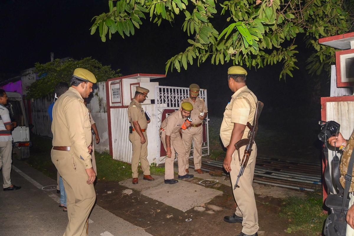 Police personnel gather near BJP MLA Sangeet Som's residence after few unknown assailants opened fire at the house in Meerut. (PTI photo)