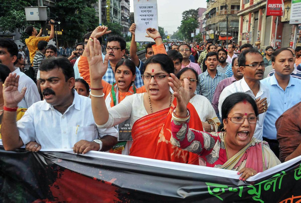 BJP wokers take out a rally against recent killings of BJP's Trilochan Mahato and Dulal Kumar in Purulia, allegedly by the Trinamool Congress party workers, in Kolkata. (PTI file photo)