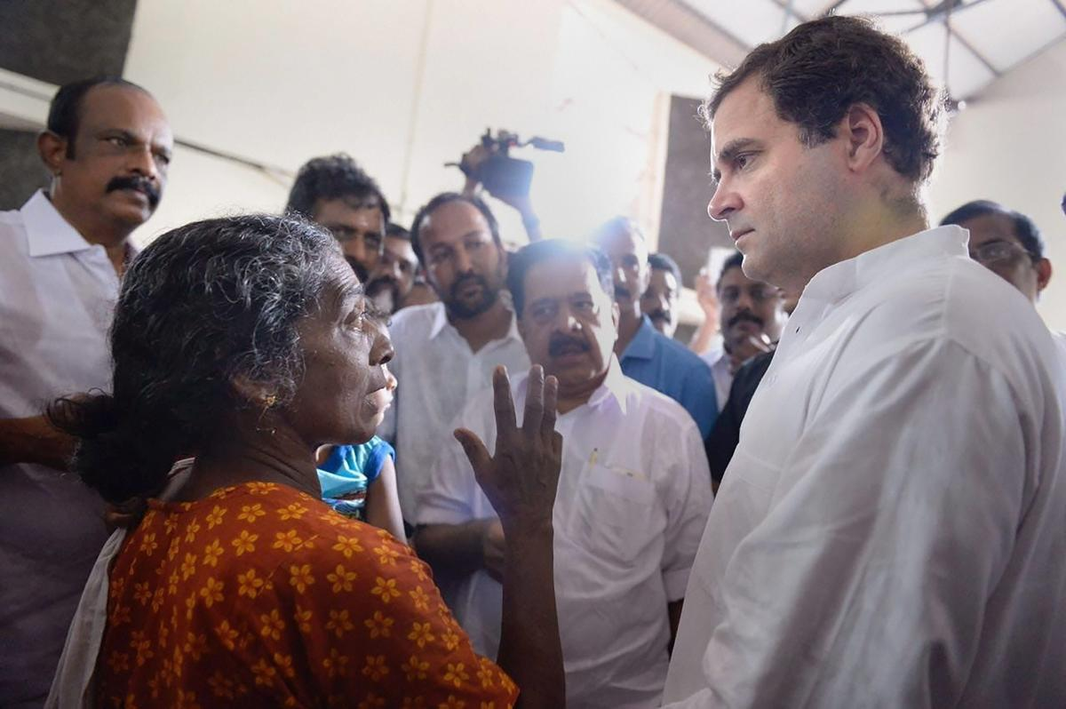 Congress President Rahul Gandhi interacts with the flood-affected people at a relief camp in Chengannur, Kerala on Tuesday, August 28, 2018. (PTI Photo)