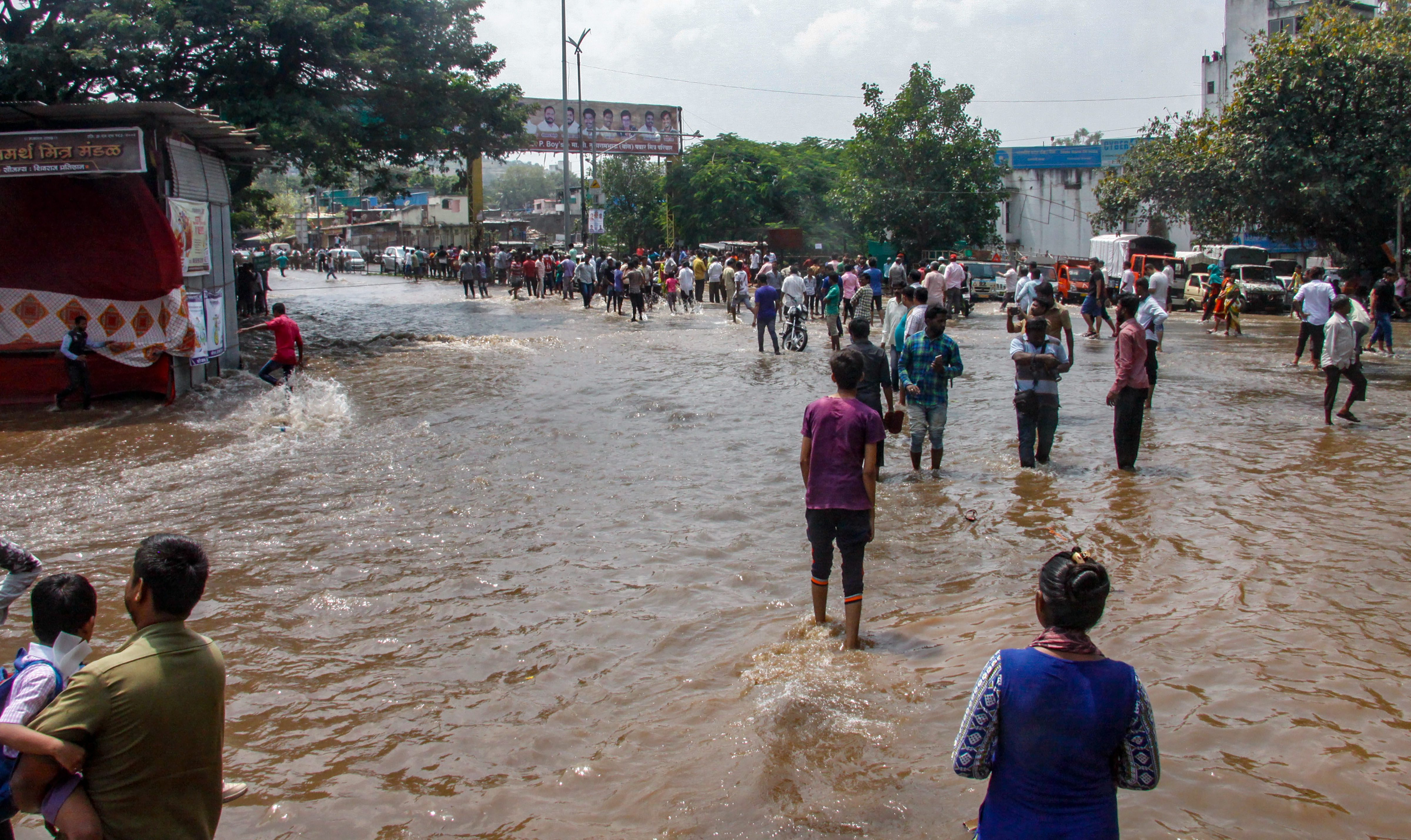 Waterlogging at a road after a breach occurred in a wall of the Mutha canal near Dandekar bridge in Pune on Thursday. PTI