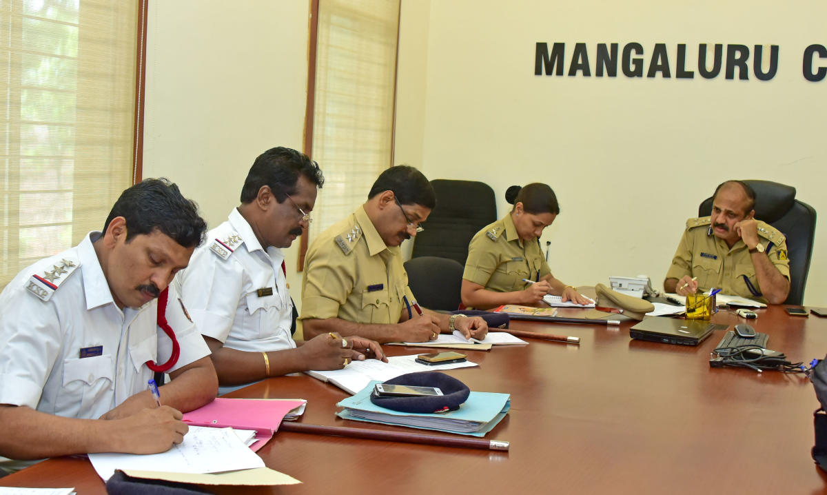 City Police Commissioner T R Suresh, DCP (Crime and Traffic) Uma Prashanth and other officials listen to the grievances of public during the monthly phone-in programme organised by Mangaluru Police Commissionerate on Friday.