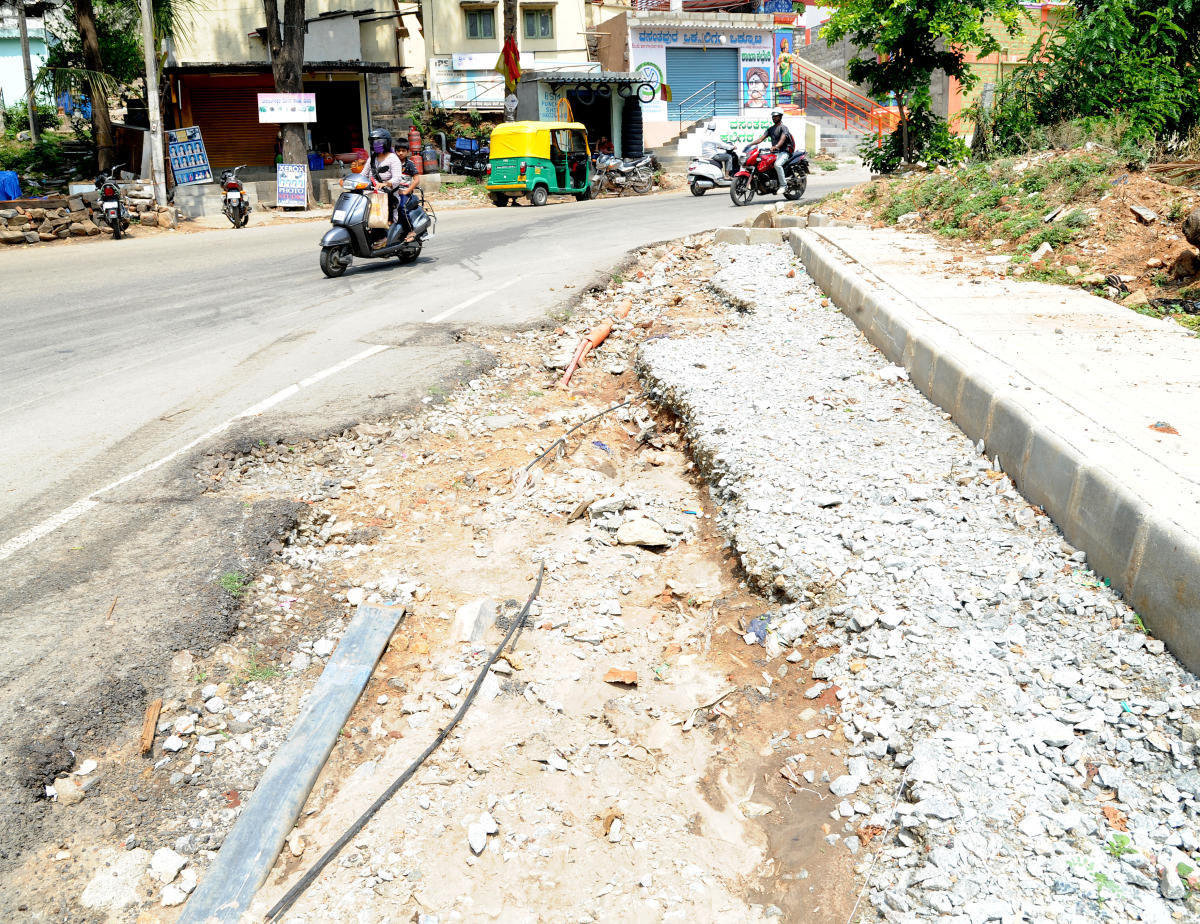 The OFC cable companies left out with out proper repair of the dug-up road at Vasantapura of Bengaluru south on Wednesday. Photo Srikanta Sharma R.
