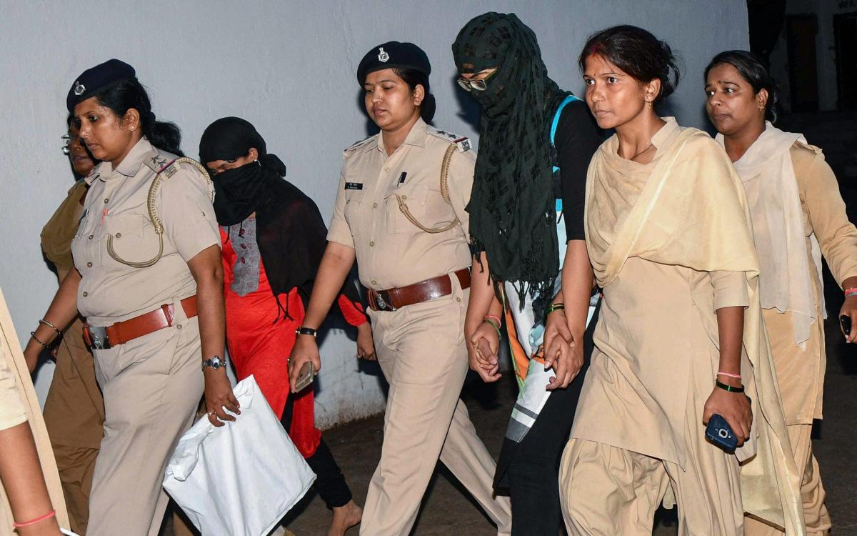 Police personnel produce Manisha, a secretary at an NGO which ran the shelter home for mentally-challenged women where two inmates died under mysterious circumstances, at a civil court, in Patna on Monday. PTI