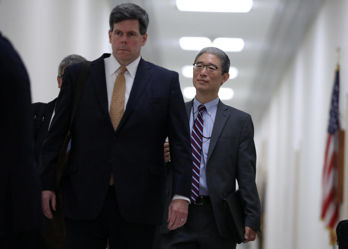 Former associate deputy US attorney general Bruce Ohr (right) arrives to testify behind closed doors before the House Judiciary and House Oversight and Government Reform Committees on his alleged contacts with Fusion GPS founder Glenn Simpson and former British spy Christopher Steele, who compiled a 'dossier' of allegations linking Donald Trump to Russia, on Capitol Hill in Washington on August 28, 2018. Reuters