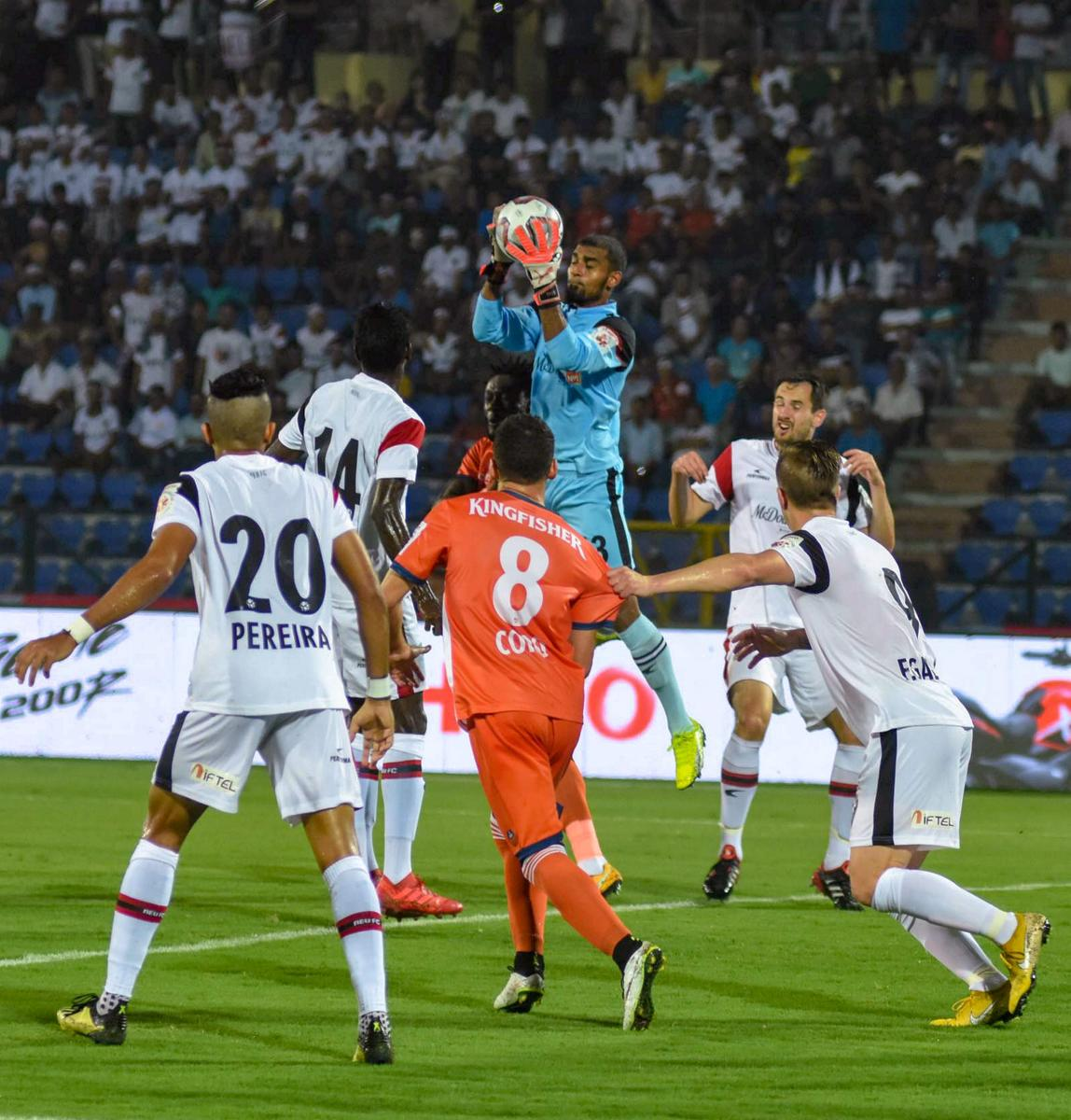 ACTION-PACKED: NorthEast United FC goalkeeper TP Rehenesh collects the ball during their match against FC Goa during their ISL match in Guwahati on Monday. (PTI Photo)