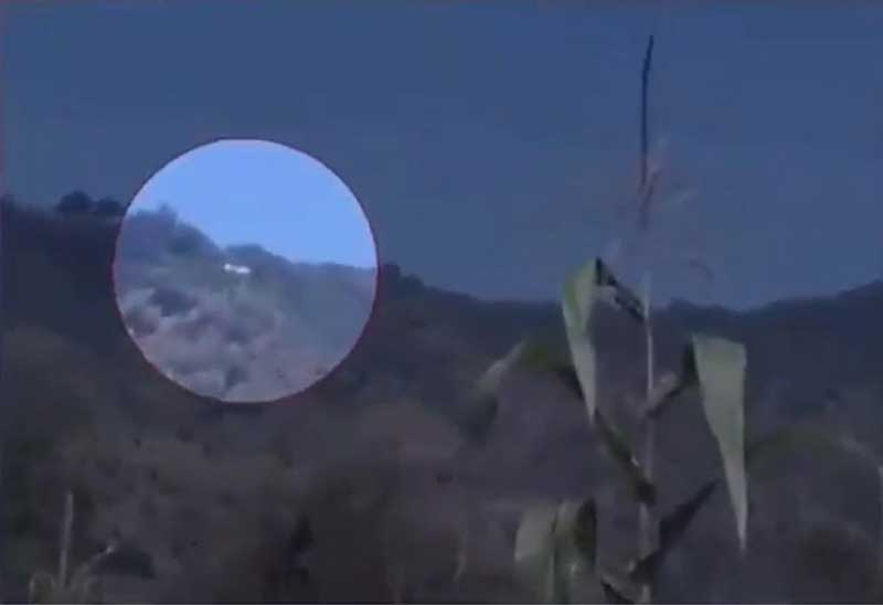 In a video, apparently shot by a witness, the copter is seen flying high near the side of a hill in Poonch. The sound of constant gunfire can be heard, indicating the Indian Army tried to shoot it down. (Screengrab)