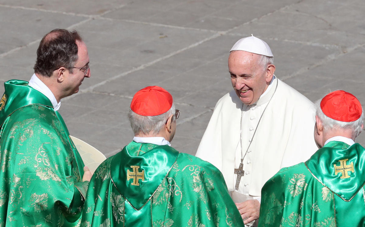 Pope Francis greets cardinals at the end of a mass for the opening of a synodal meeting in Saint Peter's square, at the Vatican. (Reuters photo)