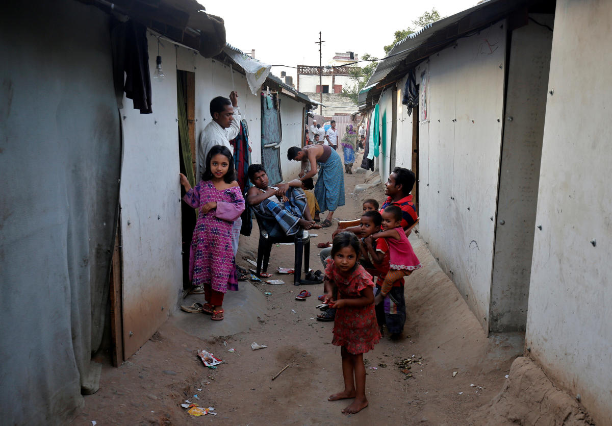 People belonging to Rohingya Muslim community sit outside their makeshift houses on the outskirts of Jammu. Picture taken on May 5, 2017. REUTERS/Mukesh Gupta/File Photo