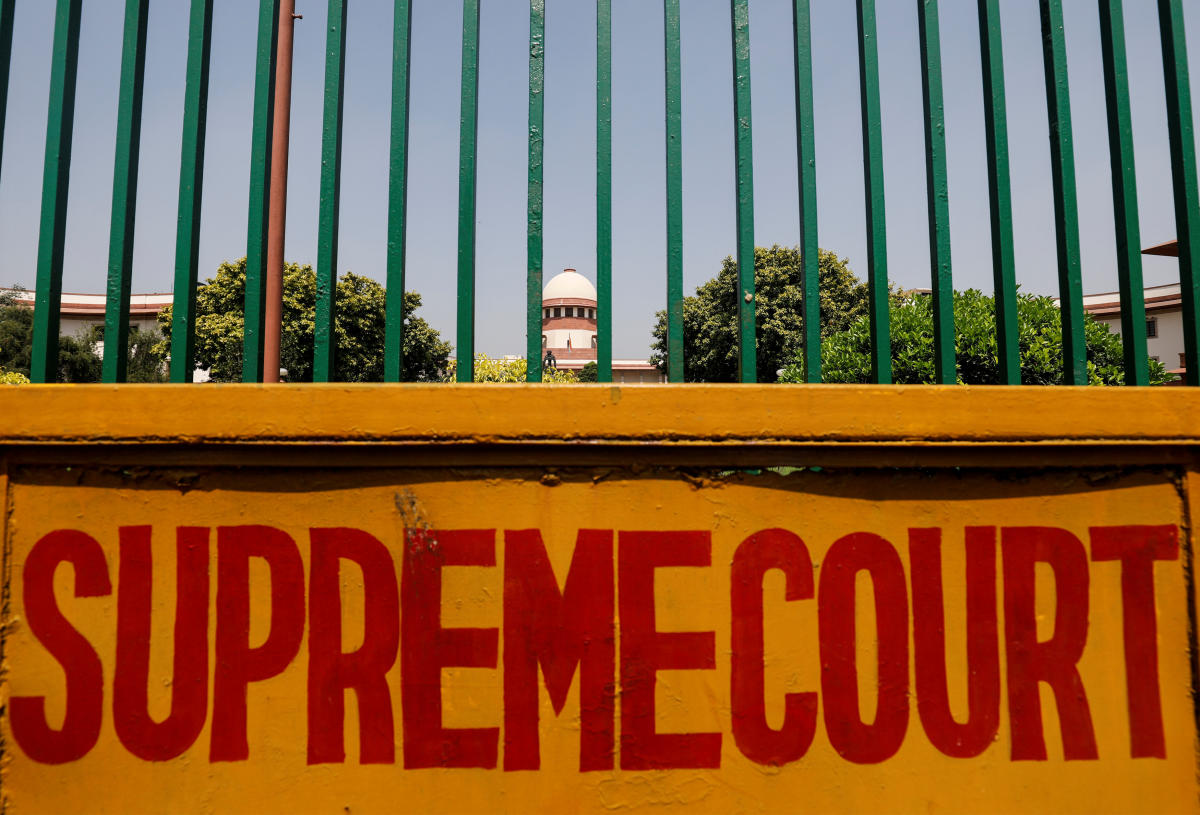 A signboard is seen outside the premises of Supreme Court in New Delhi. (REUTERS)