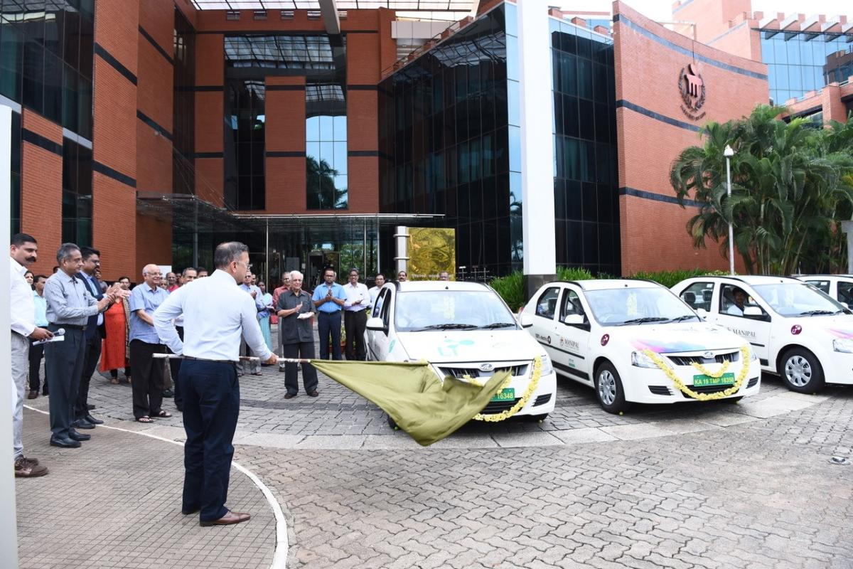 Dr Ranjan Pai, Chairman, Manipal Education and Medical Group, flags off a fleet of electric cars in Manipal.