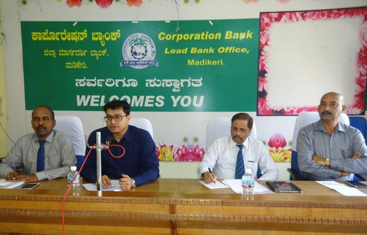Zilla Panchayat CEO Prashanth Kumar Mishra chairs the district lead bank meeting in Madikeri on Wednesday.