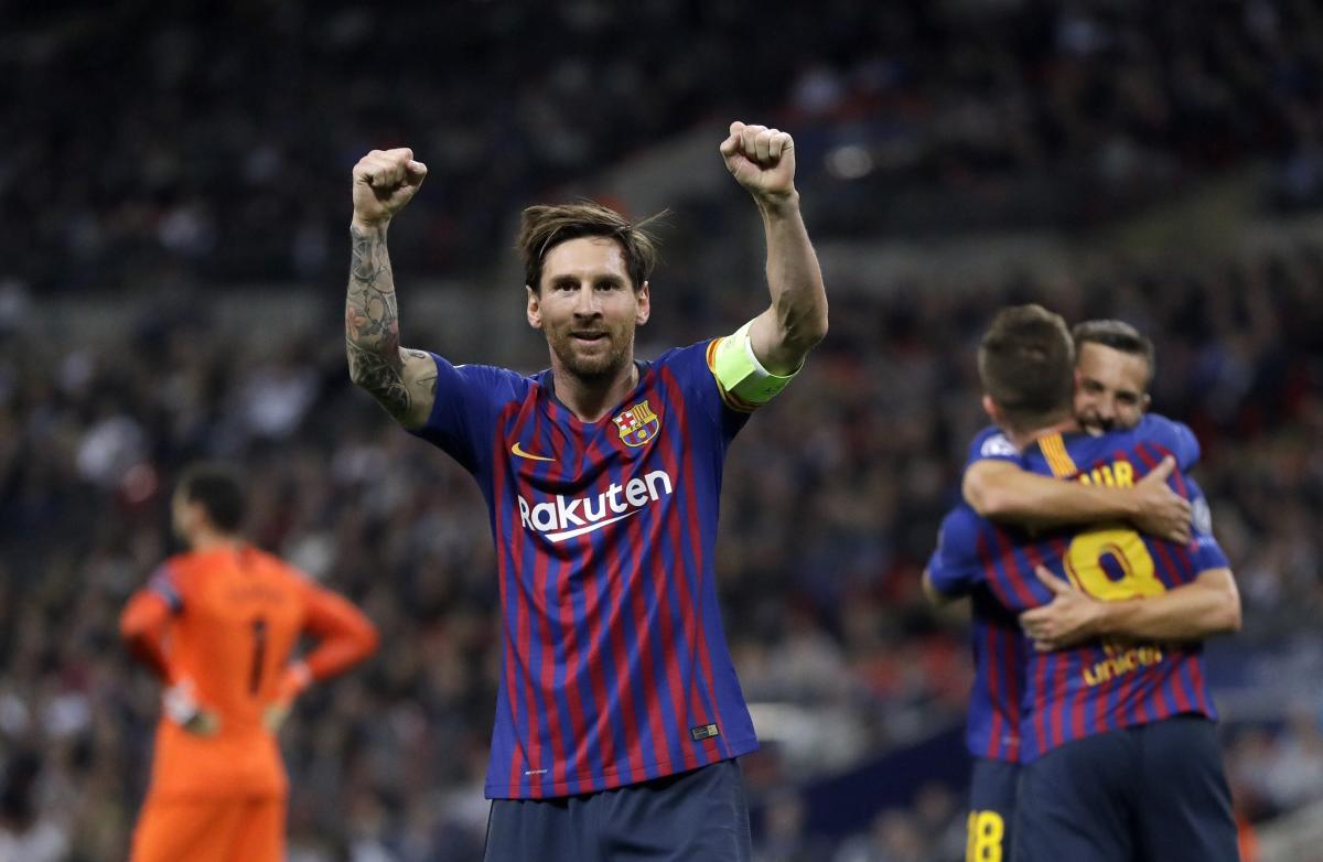 Barcelona forward Lionel Messi, center, celebrates after scoring his side's third goal during the Champions League Group B soccer match between Tottenham Hotspur and Barcelona at Wembley Stadium in London on Wednesday.(AP/PTI)
