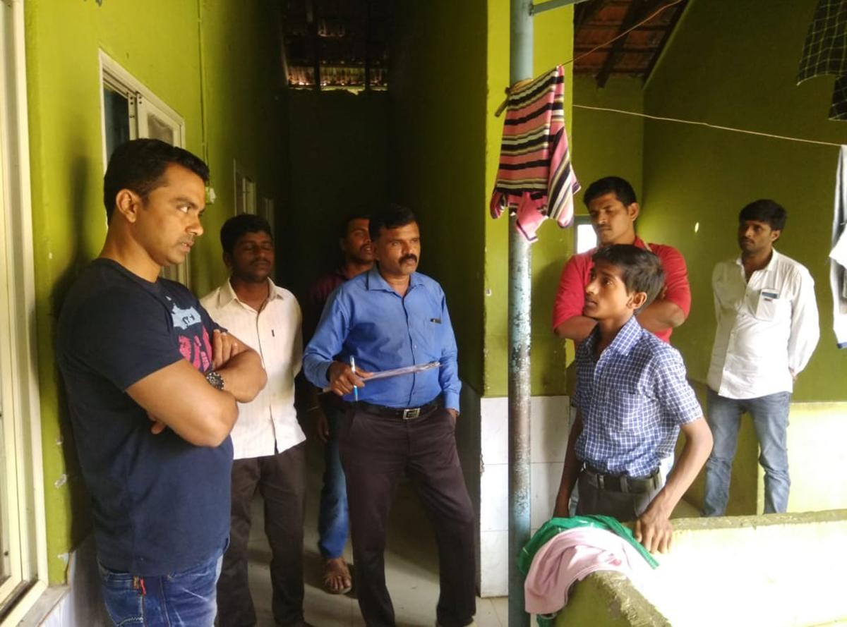Lokayukta Inspector Sachin listens to woes of the students in the Government Boys' Hostel in Mudigere on Thursday during a surprise visit.