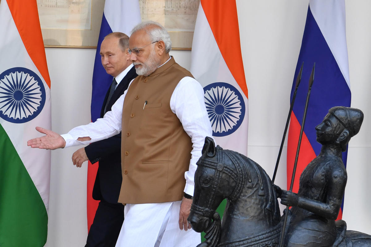 Indian Prime Minister Narendra Modi shows the way to Russian President Vladimir Putin prior to their meeting at Hyderabad House in New Delhi, India, October 5, 2018. (REUTERS)