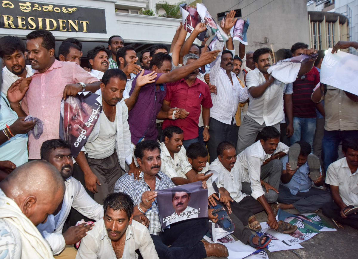 Supporters of B Y Vijayendra, the BJP ticket aspirant for Varuna Assembly constituency stage a protest in Mysuru on Monday, demanding that the party leadership announce his candidature. dh photo