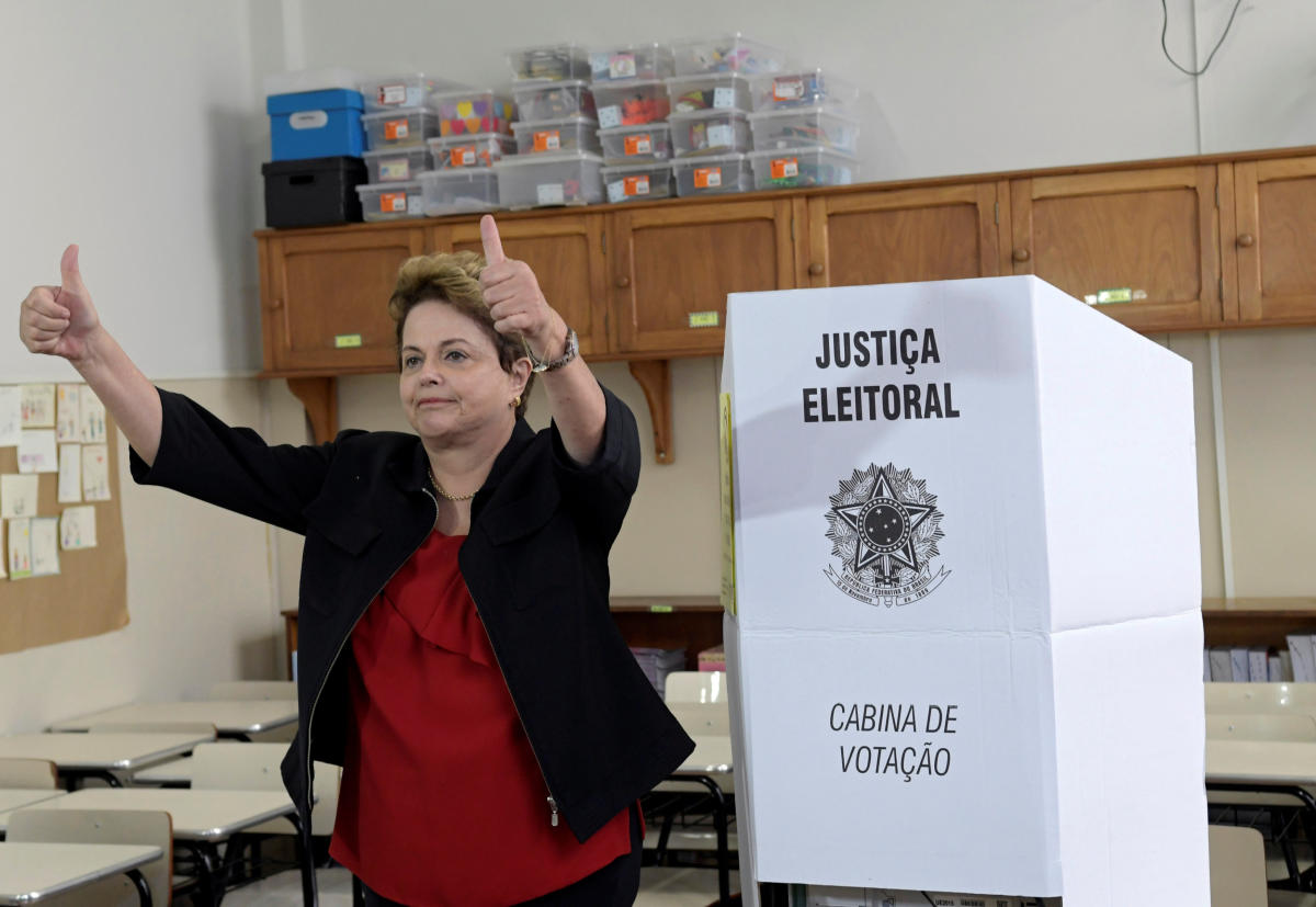 Brazil's former president and senate candidate Dilma Rousseff of the leftist Workers Party (PT) gestures after casting her vote, in Belo Horizonte, Brazil October 7, 2018. REUTERS