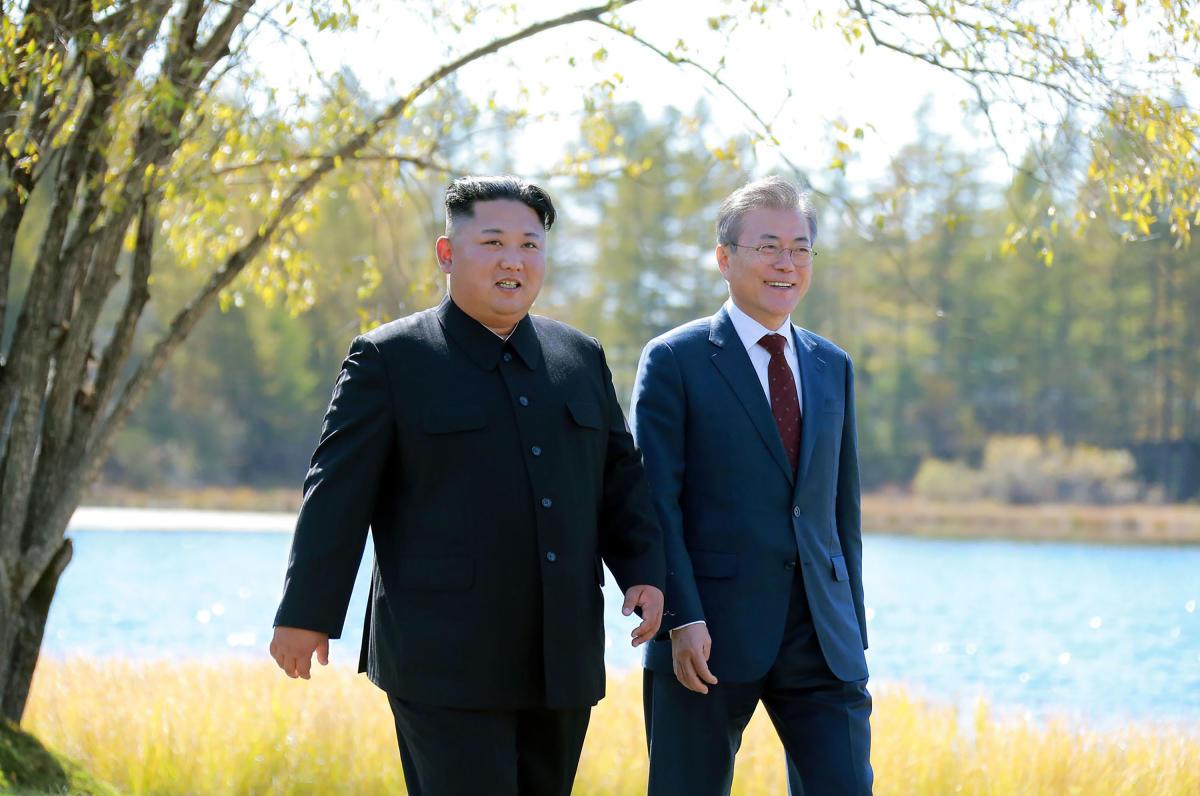 North Korea's leader Kim Jong-un and South Korean President Moon Jae-in at the Samjiyon guesthouse near Mount Paektu in Samjiyon on September 20, 2018. AFP