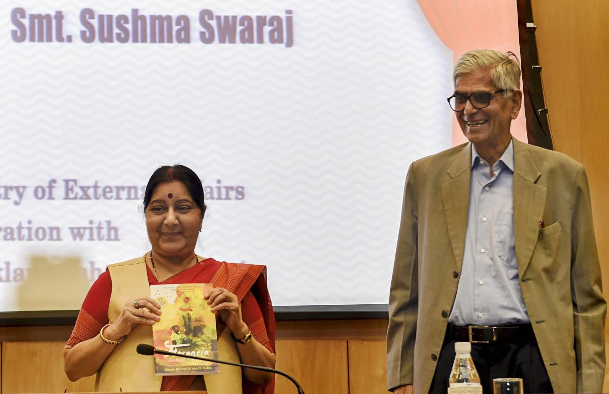 Union External Affairs Minister Sushma Swaraj releases a publication as Jaipur Foot Organisation founder DR Mehta looks on, at the launch of 'India For Humanity' initiative in New Delhi on Tuesday. PTI