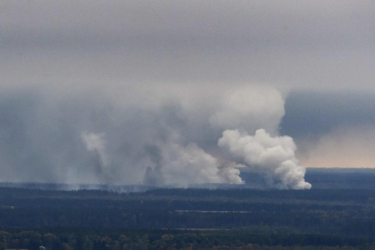 Smoke rises after a fire and explosions hit the Ukrainian defence ministry ammunition depot in the eastern Chernihiv region, Ukraine on October 9, 2018. Reuters