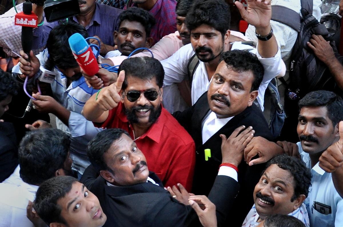 Senior journalist R Gopal, editor of Tamil magazine 'Nakkheeran', addresses the media as he is being taken to court, in Chennai, on Tuesday. The weekly's website claimed Gopal was arrested based on a complaint from the Raj Bhavan over a write-up on Nirmala Devi, an assistant professor of a private college in Virudhunagar who had been arrested for allegedly prodding girl students to extend sexual favours to officials. PTI