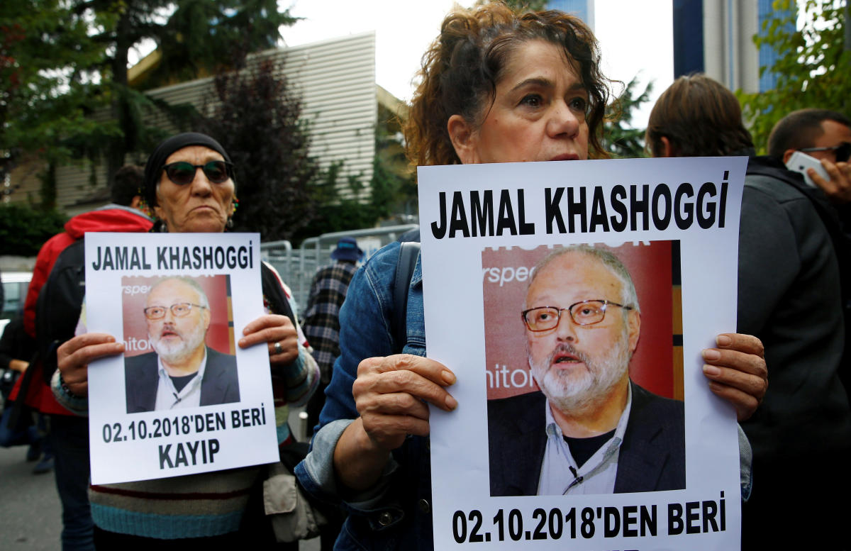 Human rights activists hold pictures of Saudi journalist Jamal Khashoggi during a protest outside the Saudi Consulate in Istanbul, Turkey October 9, 2018. (REUTERS)