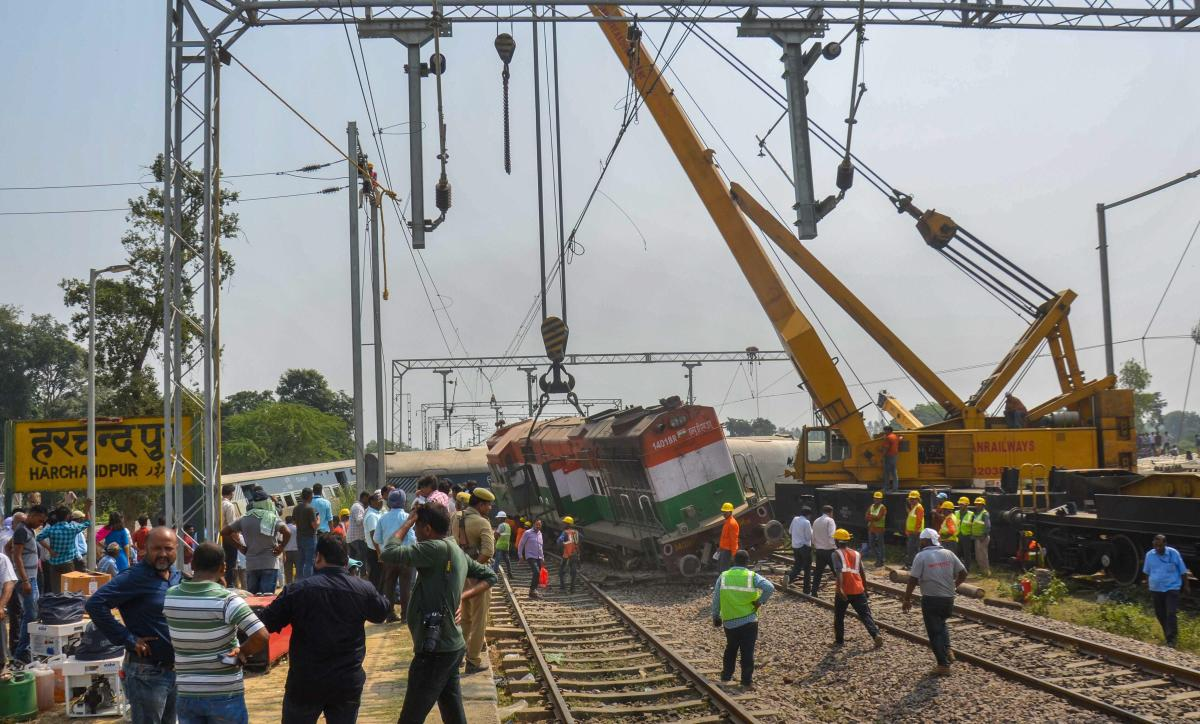 Cranes remove the train from the site of the accident where eight coaches and engine of the New Farakka Express train derailed near Raebareli, Wednesday, Oct 10, 2018. At least six people were killed in the accident. (PTI Photo)