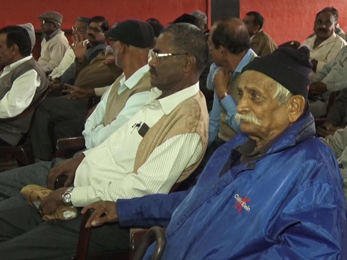 Ex-servicemen take part in a get-together at Kodava Samaja in Madikeri on Sunday.