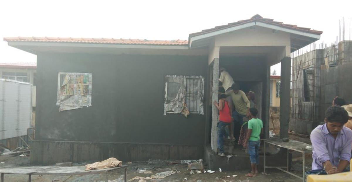 Labourers give final touches to a house at Galibeedu Gram Panchayat limits in Madikeri taluk.