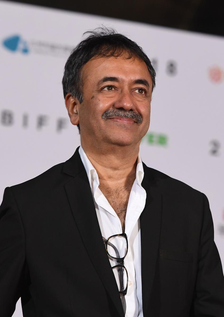 Indian film director Rajkumar Hirani looks on as he walks on the red carpet during the opening ceremony of the 23rd Busan International Film Festival (BIFF) at Busan Cinema Center in Busan on October 4, 2018. - The festival opens on October 4, with the wo