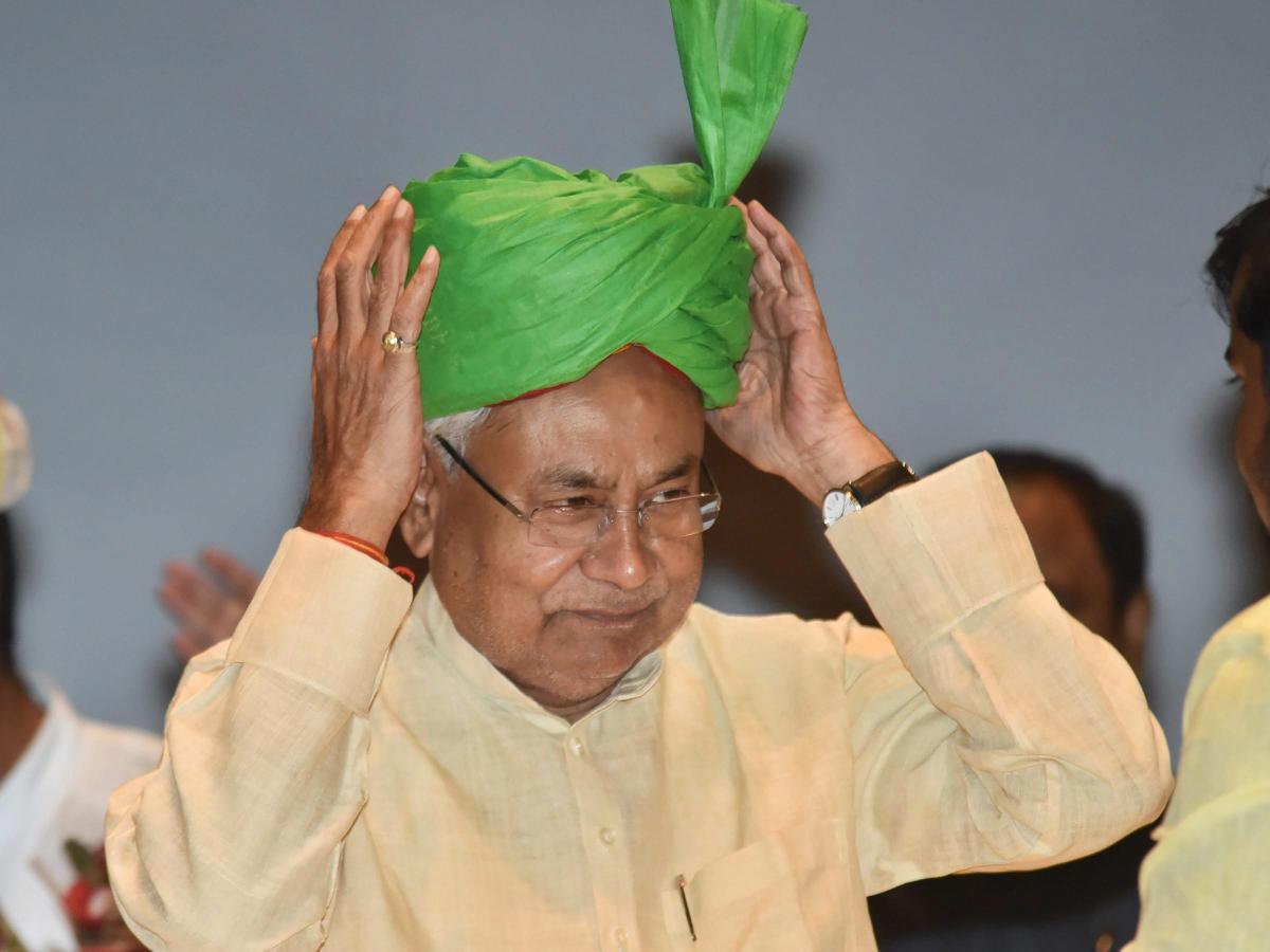 Bihar Chief Minister Nitish Kumar adjusts the turban during 'Virat Chhatra Sanagam', in Patna, Thursday, Oct 11, 2018. (PTI Photo)
