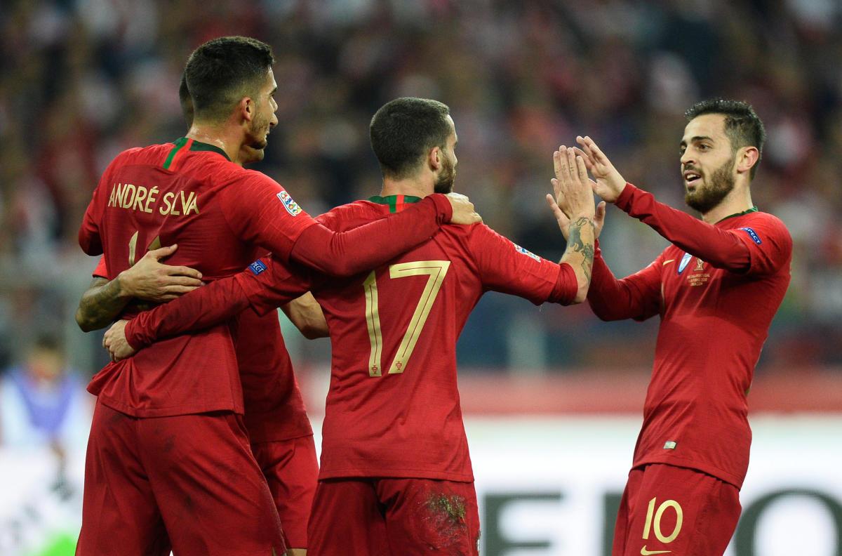 Portugal's Bernardo Silva (right) celebrates with team-mates after scoring against Poland. REUTERS