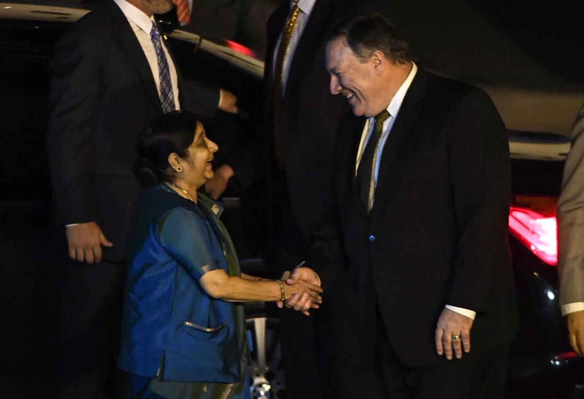 US Secretary of State Mike Pompeo (R) shakes hands with Indian Foreign Minister Sushma Swaraj after arriving at Air Force Station Palam in New Delhi on September 5, 2018. - US Secretary of State Mike Pompeo and Secretary of Defense Jim Mattis and their Indian counterparts are meeting in New Delhi on September 6, where they will discuss a number of issues on trade and defense. (Photo by PRAKASH SINGH / AFP)