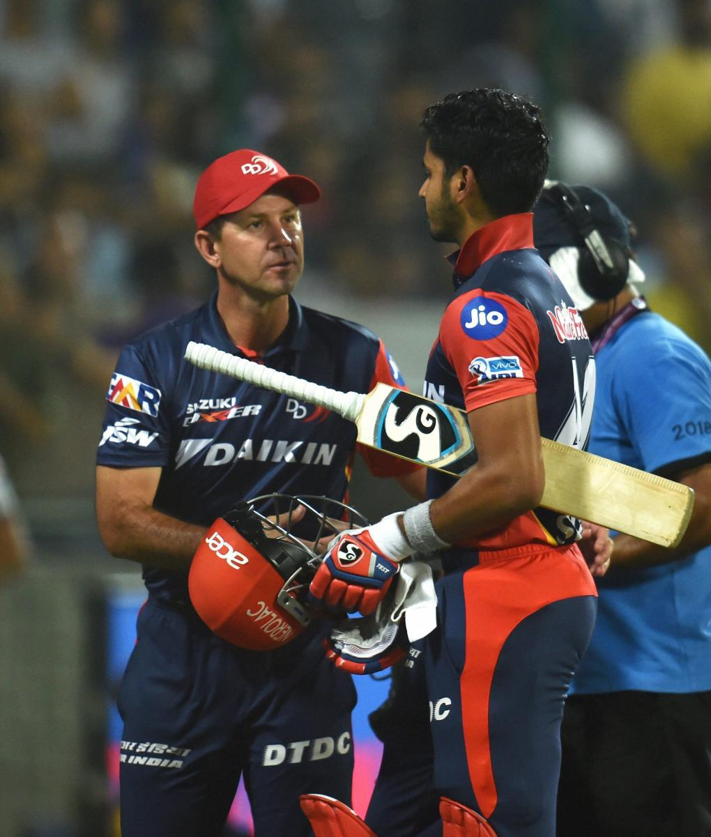 Delhi Daredevils' skipper Shreyas Iyer (right) is greeted by team coach Ricky Ponting during their match against Kolkata Knight Riders in New Delhi, on Friday. PTI