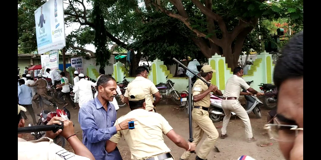 Police caned the unruly mob and arrested over 20 protesters.