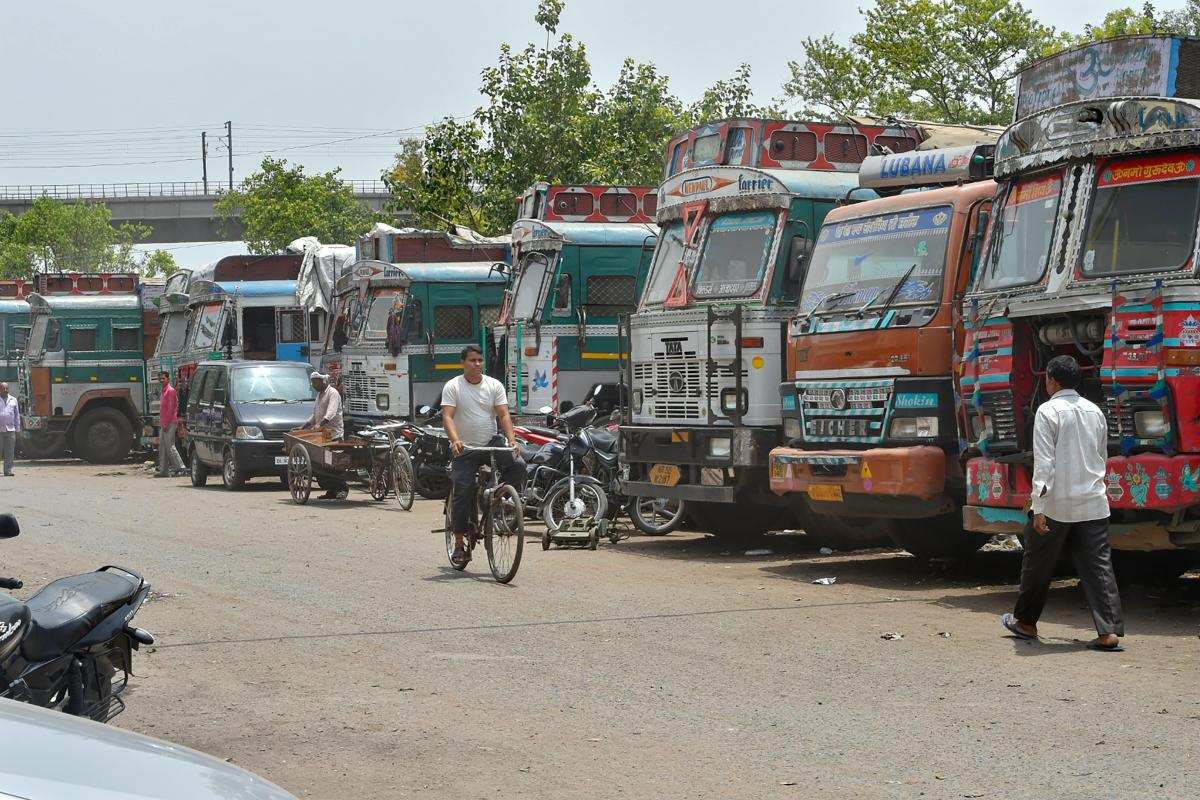 Trucks stand idle at Azadpur Subzi Mandi, in New Delhi on Monday, June 18, 2018. Truck owners and operators are protesting against fuel price hike and third party insurance premium hike in a nationwide strike today. ( PTI Photo/ Shahbaz Khan)