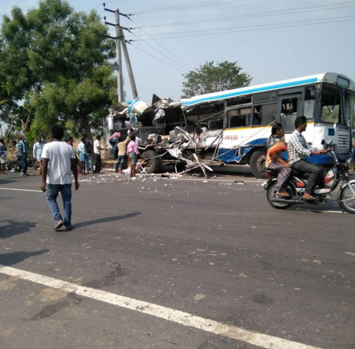 The mangled remains of the ill-fated TSRTC bus, near Karimnagar on Tuesday.