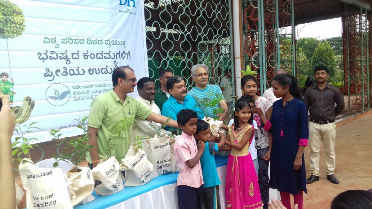 A photo from plant distribution programme by DH-Prajavani.