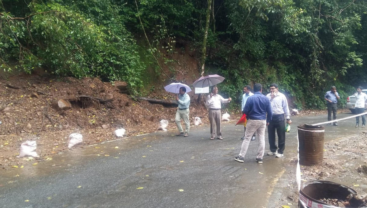 Experts from NITK, Surathkal inspect the Perumbadi-Makutta Road near Virajpet on Tuesday.